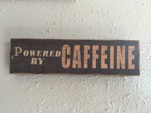 Powered by Caffeine Sign EcoTurf of Northern Colorado